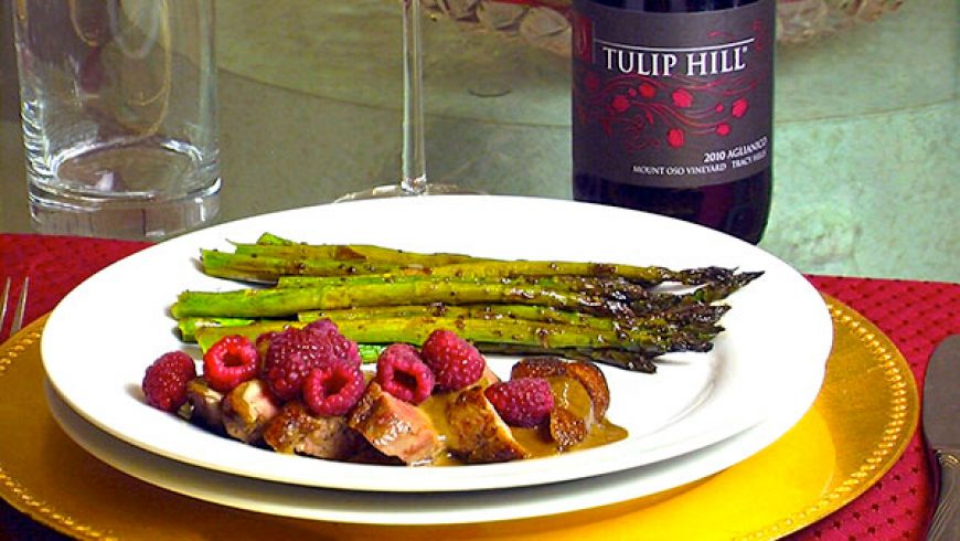Pan Seared Duck Breast with Black Cherry Vinaigrette & Raspberries